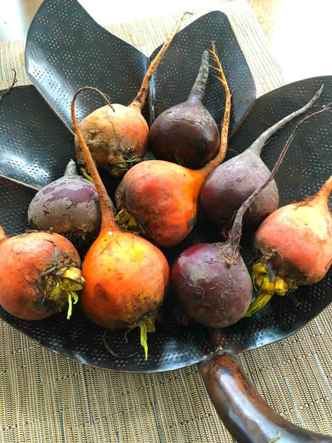 Orange and red beets in a leaf bowl