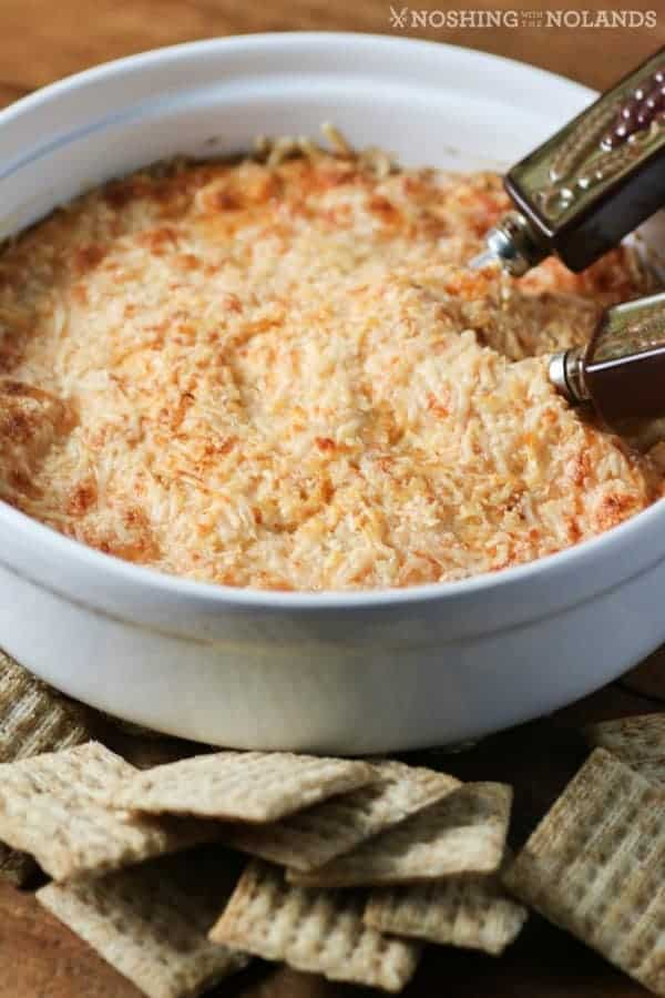 Hot Crab Dip in a white dish with crackers
