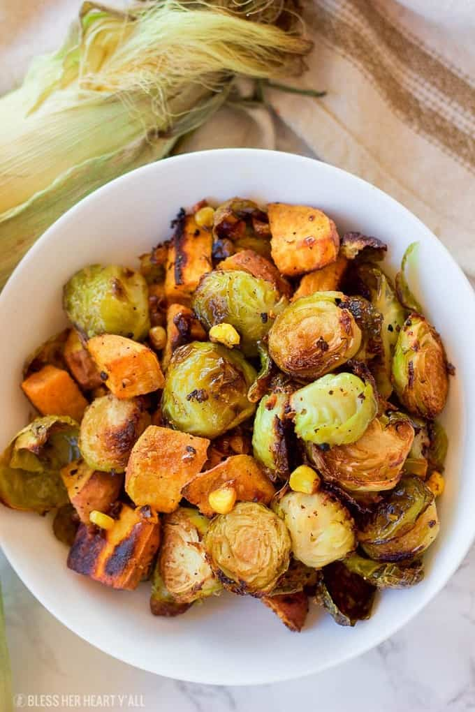 Roasted Brussel Sprouts and sweet potatoes in a white serving bowl