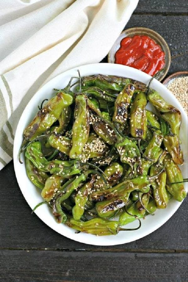 Sesame Blistered Shisito Peppers in a white bowl