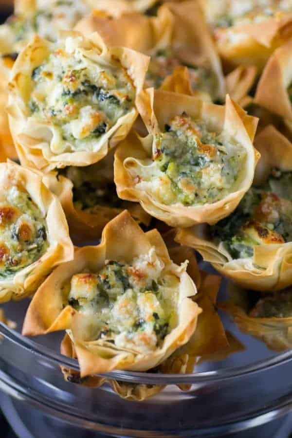 Spanakopita Tarts in a glass serving dish from 18 Easy Hot Party Appetizer Recipes