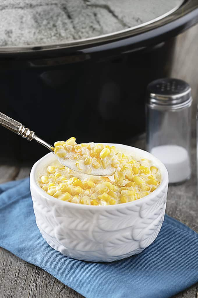 Spoonful of creamed corn for consumption.