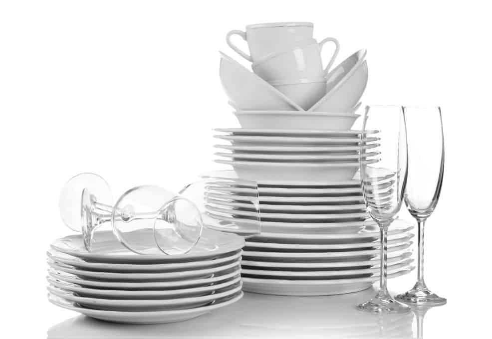 Stacked white plates and glasses