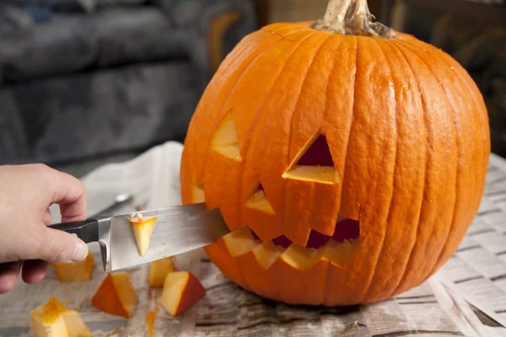 Carving a face into a pumpkin