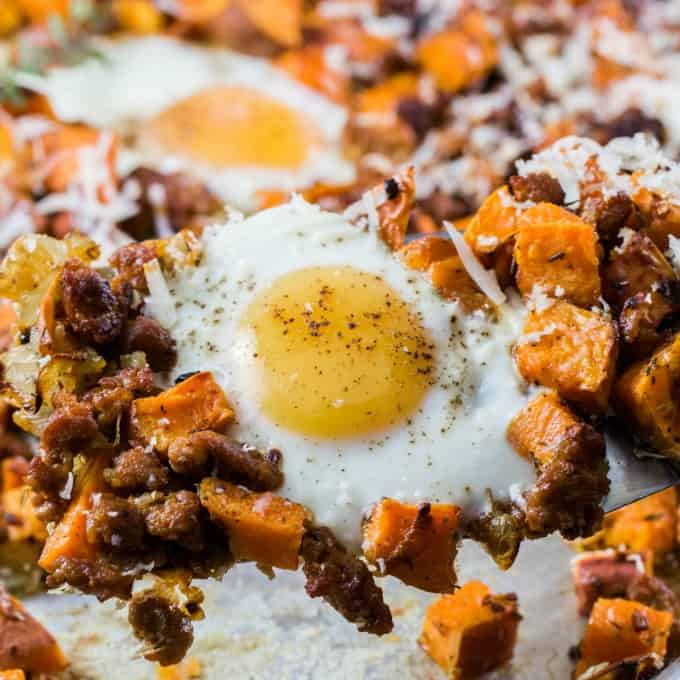 Beautiful egg with sweet potatoes and sausage on a spatula