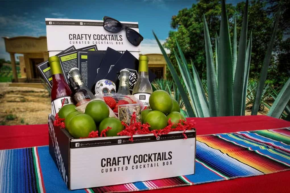 Crafty Cocktails tequila box on a table with a Mexican background