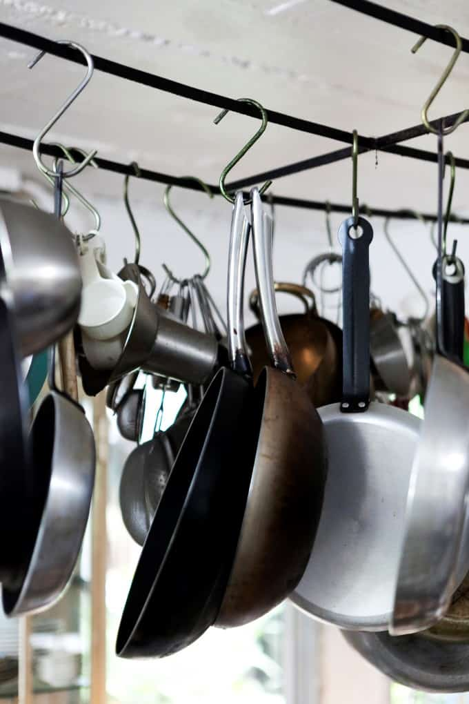 Pots and pans hanging from a rack.