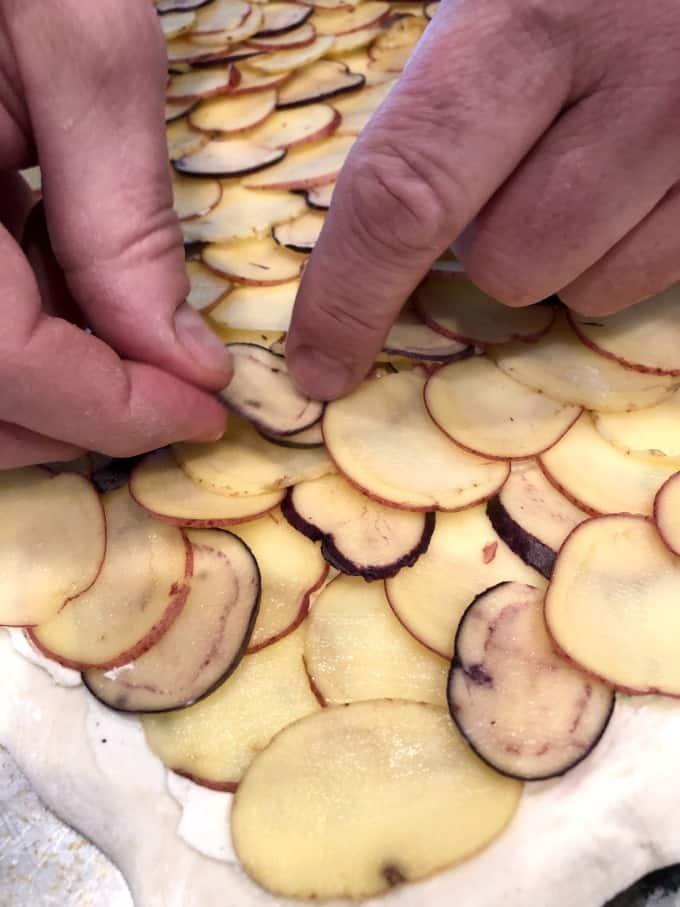 Layering potatoes on the puff pastry