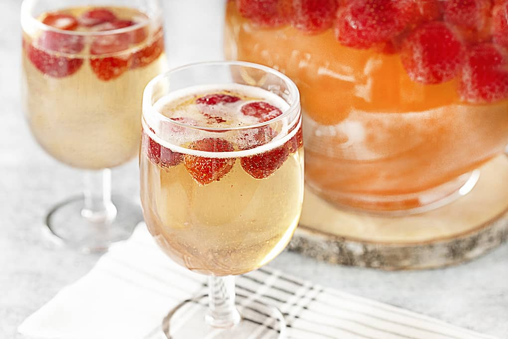 Strawberry Champagne Party Punch in glasses and a pitcher