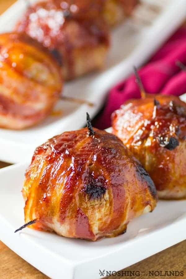 BBQ Bacon wrapped onion bombs in a white plate