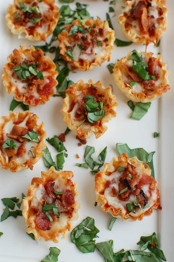 Bacon pizza bites on a white plate