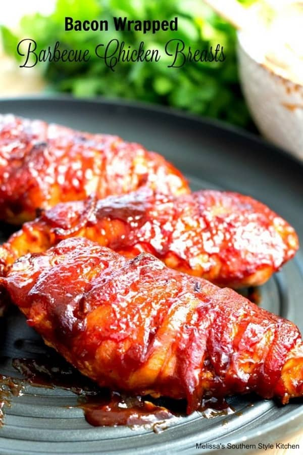 Bacon wrapped chicken breasts in a grey plate covered with BBQ sauce