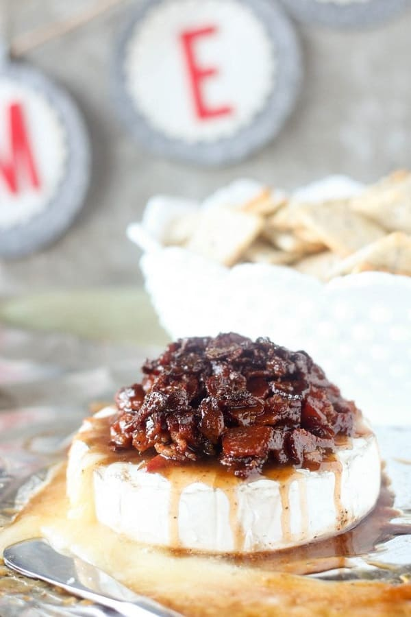 candied bacon on top of a round of brie cheese