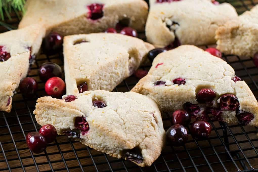 Cranberry Orange Scones on a wire rack with fresh cranberries