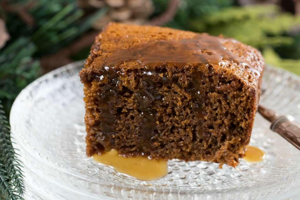 Close up of Gingerbread Cake with Calvados Caramel Sauce over top