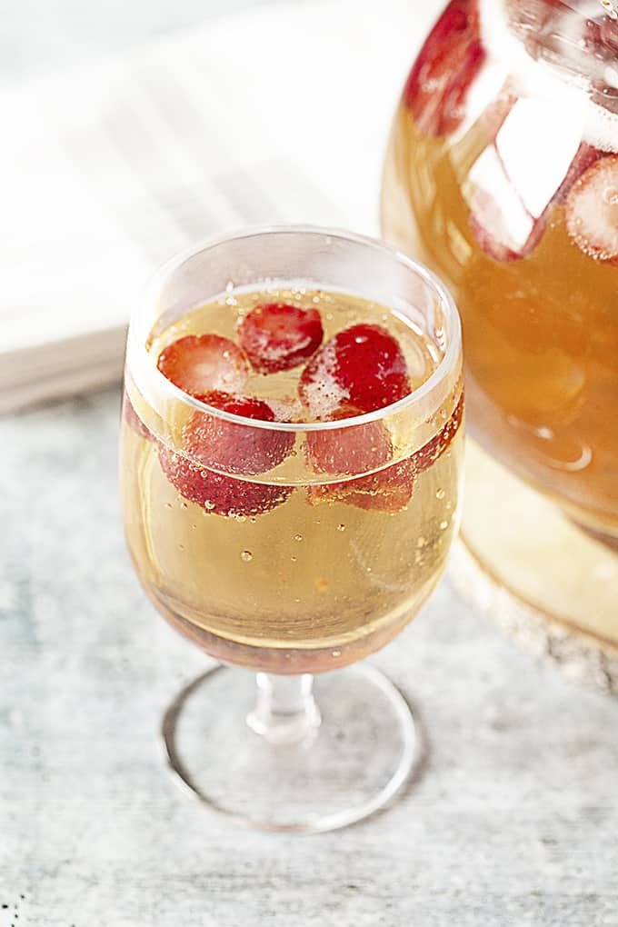 Glass of punch with strawberries