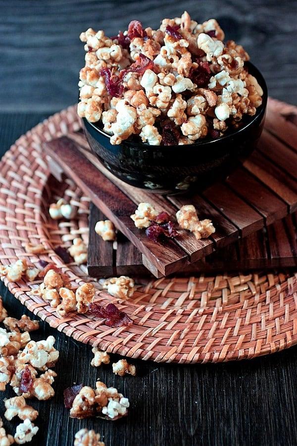 Bacon caramel corn in a black bowl