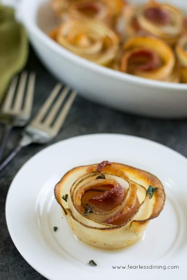 Roasted potato bacon rose on a white plate with forks