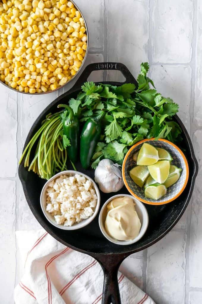 ingredients for Mexican corn dip in a cast iron pan
