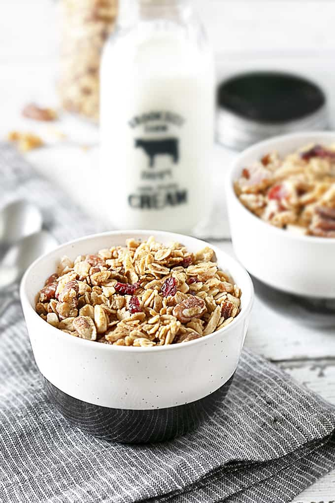 Breakfast is served in a black and white bowl, Homemade Granola.