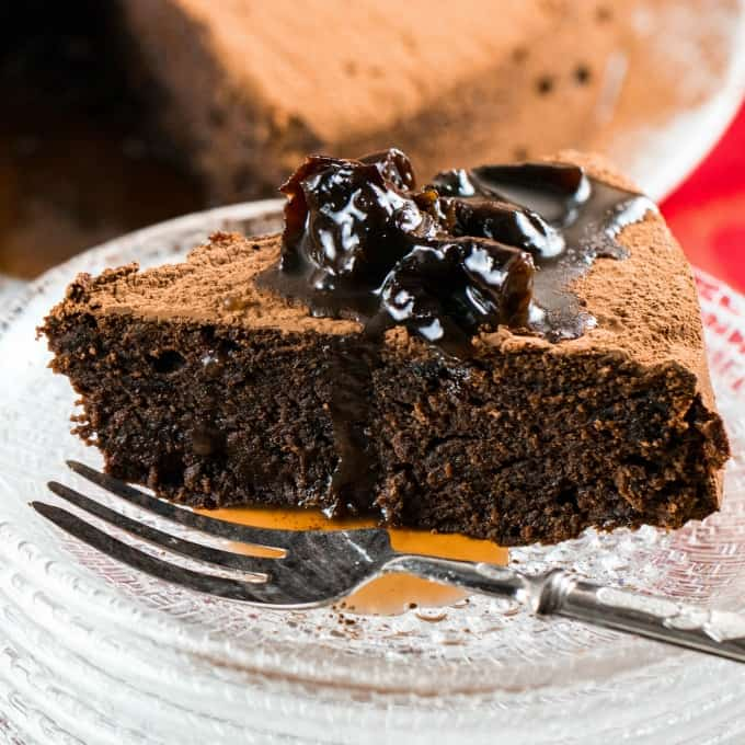 Close up of Chocolate Prune Cake on a plate with a fork