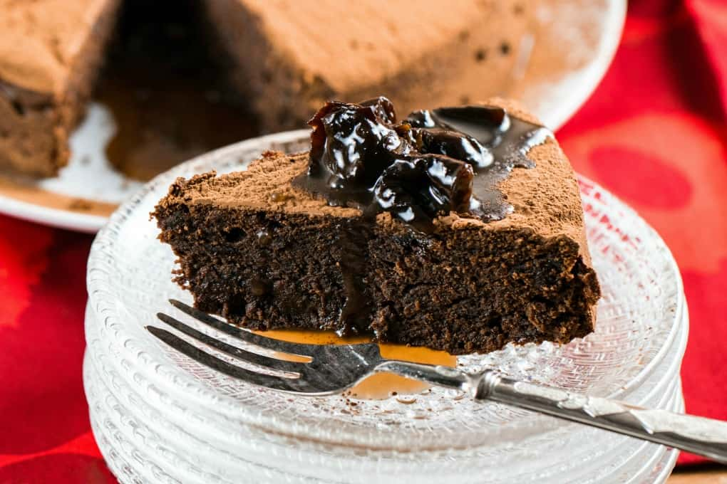 Slice of Chocolate Prune Cake on a plate with a fork