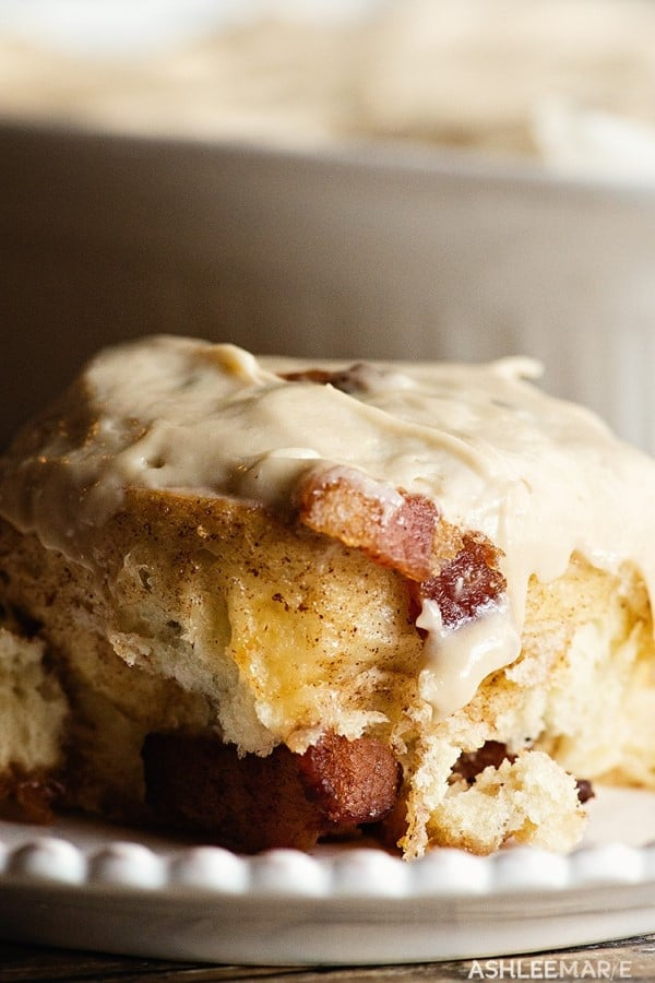 maple bacon cinnamon rolls on a white plate