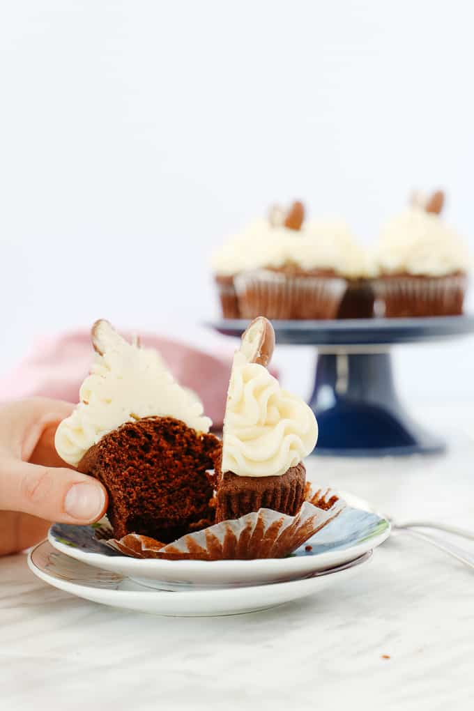 Chocolate Cupcake with buttercream frosting cut in half