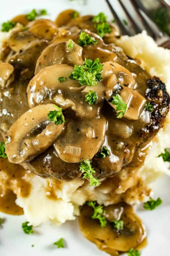 Overhead of mushrooms on Salisbury Steak