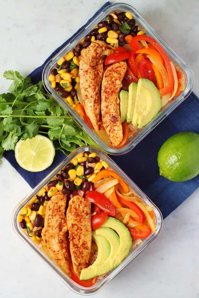 Healthy Chicken Burrito Bowl - overhead photo featuring two glass containers filled with healthy vegetables, bean salad, avocado, rice, and chicken tenders.