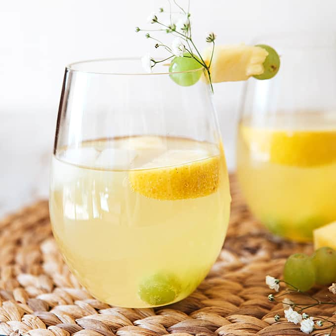 Glass of white grape and pineapple spritzer