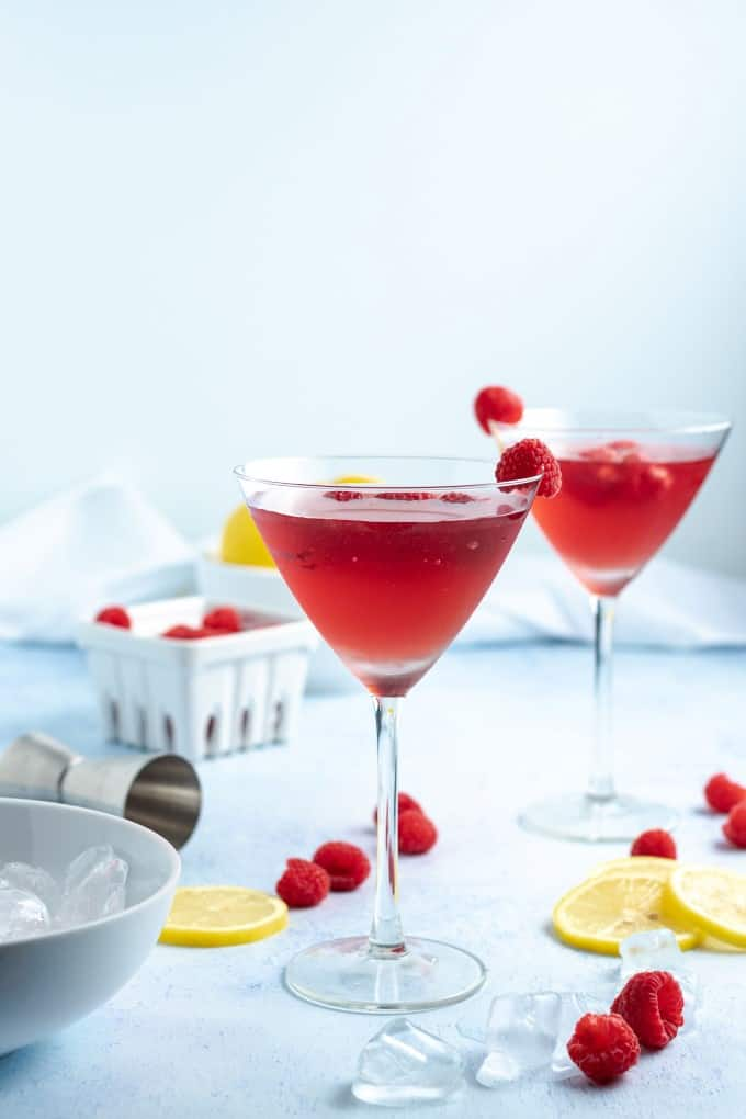 Chambord Bramble Cocktail with raspberries and lemons