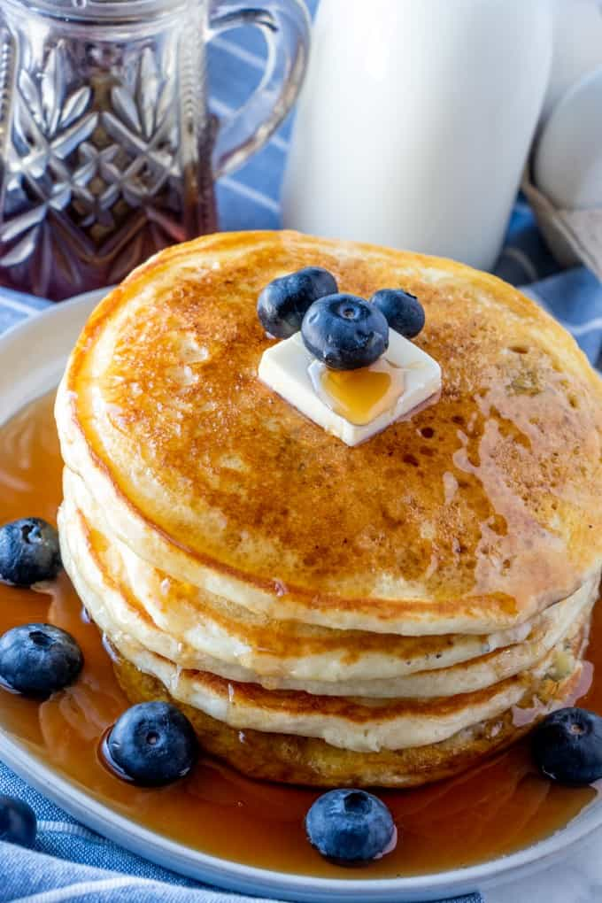 Fluffy buttermilk pancakes with lots of syrup