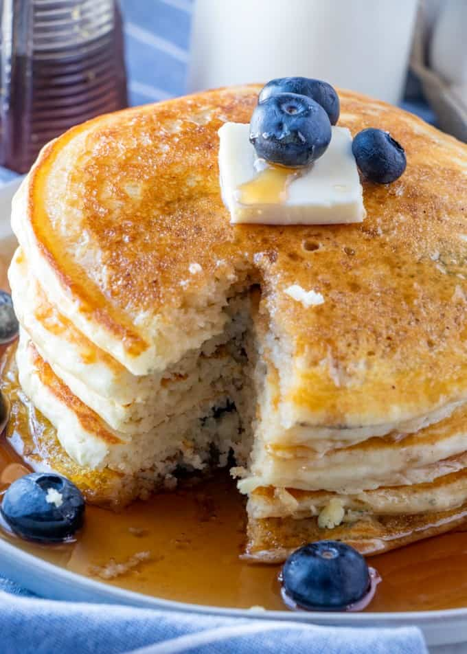 Stack of pancakes with a slice taken out