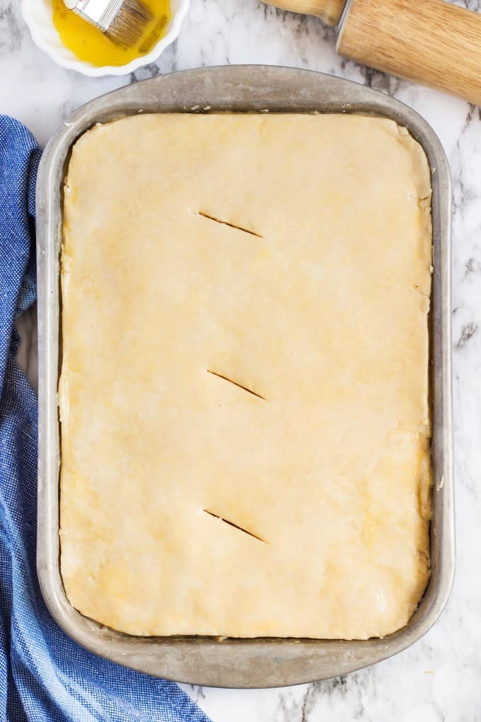 Top crust cut perfectly into a pie pan