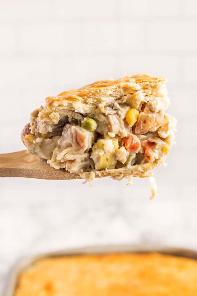 Close up of a large spoonful of chicken pot pie