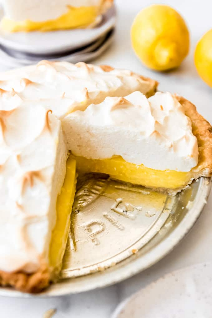 Lemon Meringue Pie - a sliced lemon meringue pie in a tin pie plate.