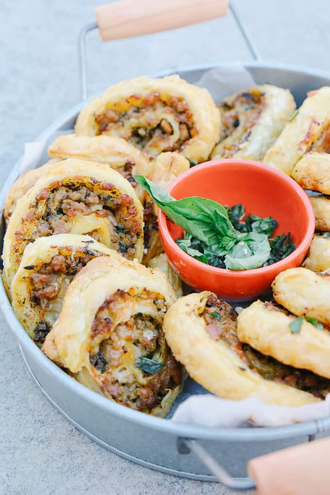 Delicious Sausage Pinwheels in a round metal bowl
