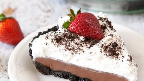 Slice of Chocolate Pudding Pie on white plate
