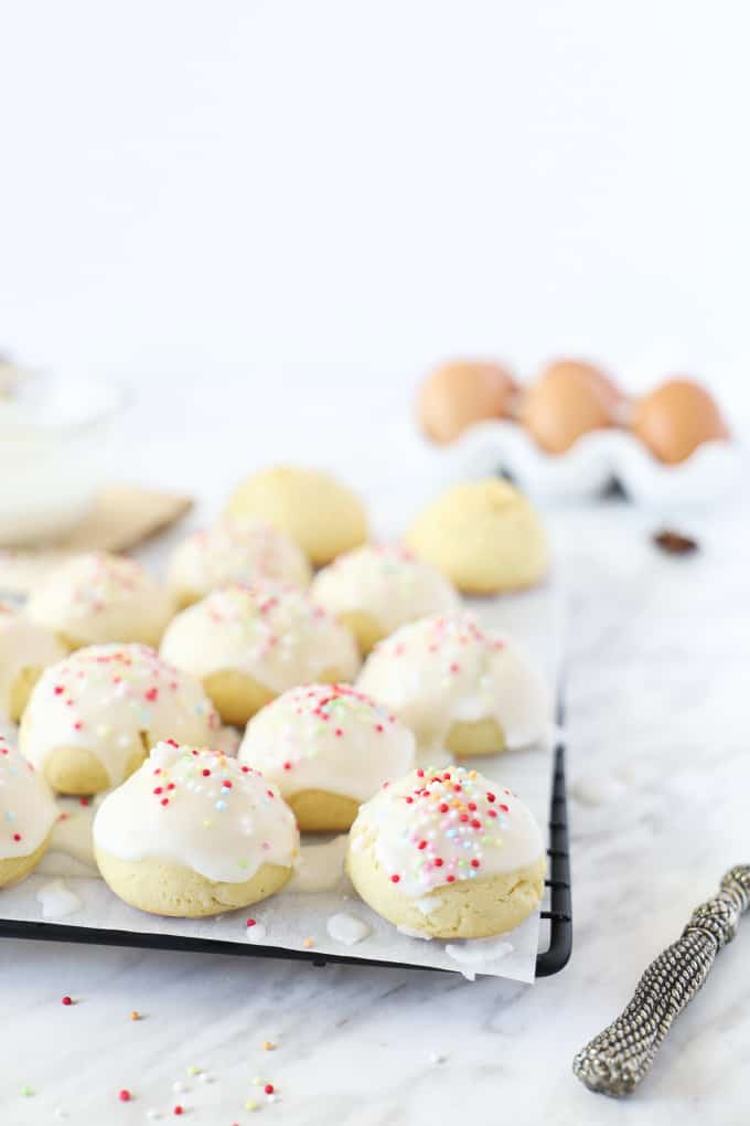 Anise cookies on parchment on a cooling rack