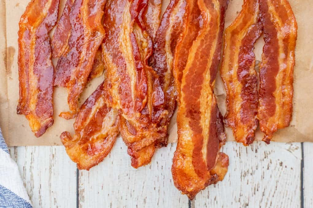 Close up of crispy cooked bacon on a paper bag