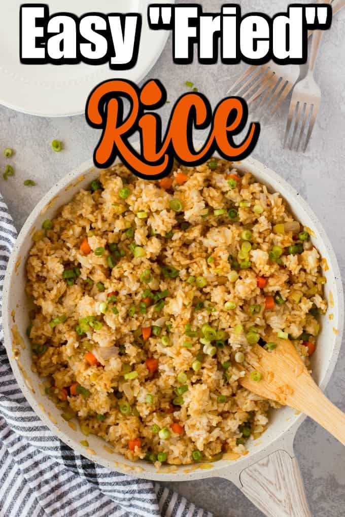 "This Easy ""Fried"" Rice is fluffy and full of flavor. It can be made quickly using just made rice so no need to pre-plan! #friedrice #easyrice #Chineserice"
