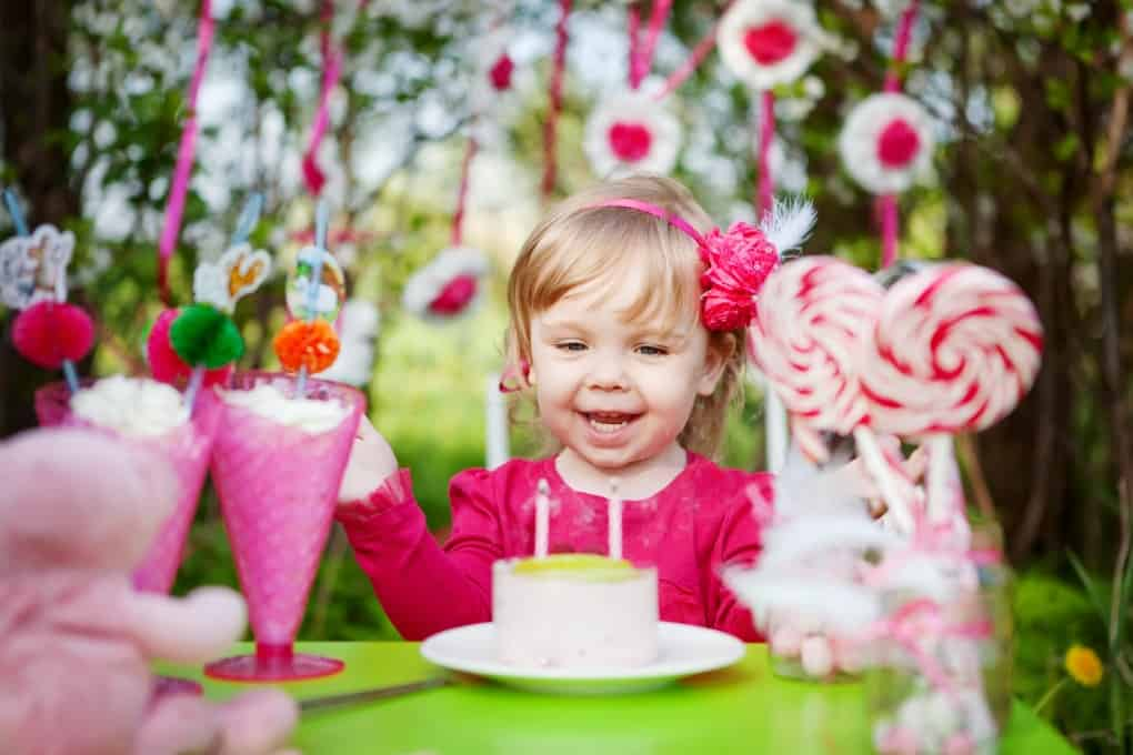 happy girl with birthday cake outdoors for Girls Birthday Party Ideas