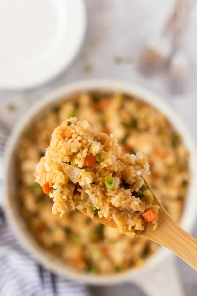 Close up shot of Fried Rice on a wooden spoon