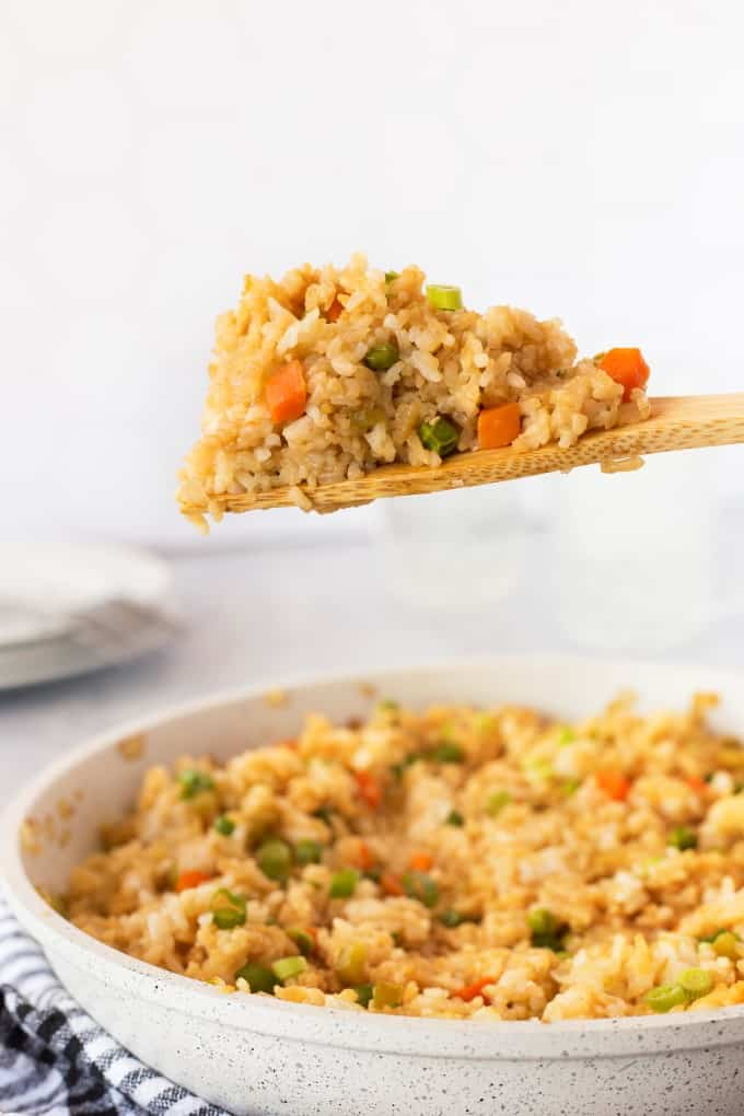 Fried rice on a wooden spoon