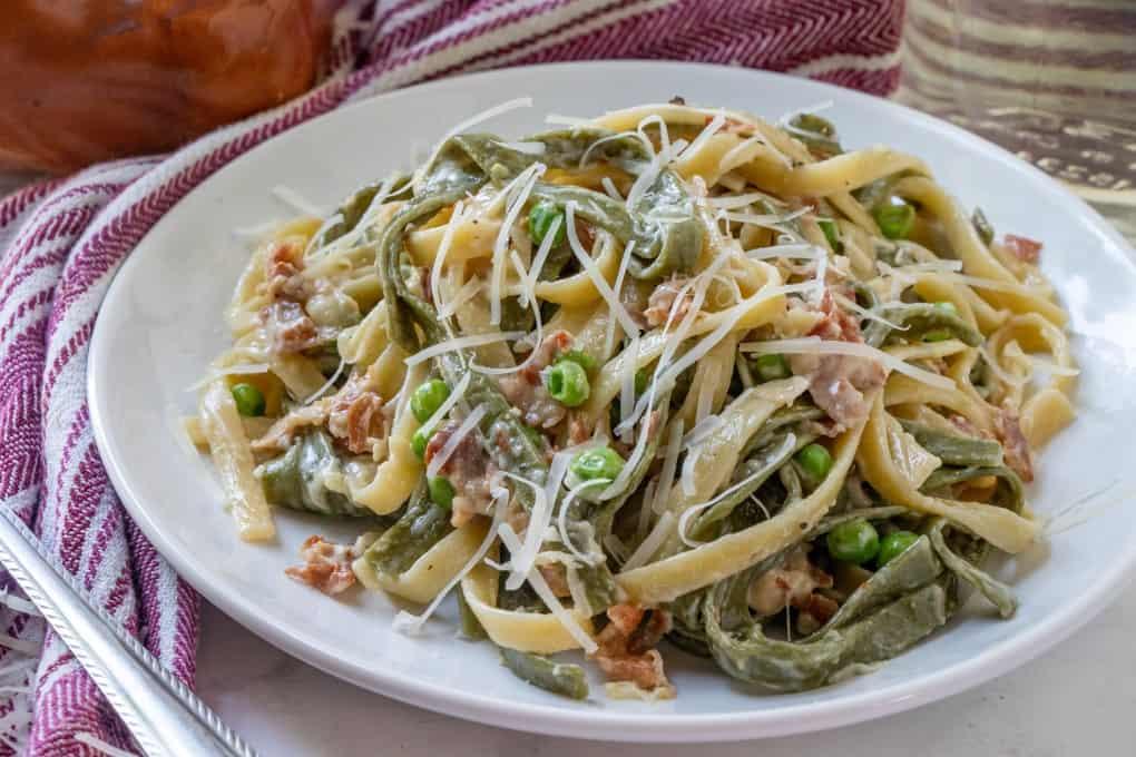 Paglia e Fieno pasta on a white plate