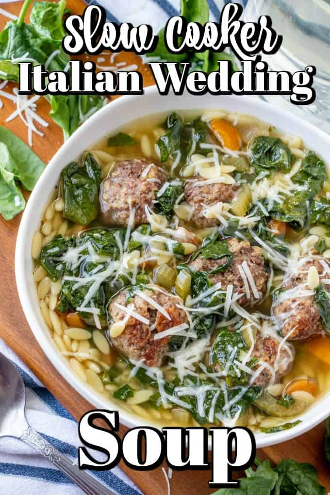 This hearty, healthy Slow Cooker Italian Wedding Soup will quickly become a favorite in your house as it has ours. Filled with chicken broth, carrots, onions, celery, spinach, and tiny meatballs it is a soup to ponder and enjoy! #ItalianWeddingSoup #slowcooker #soup