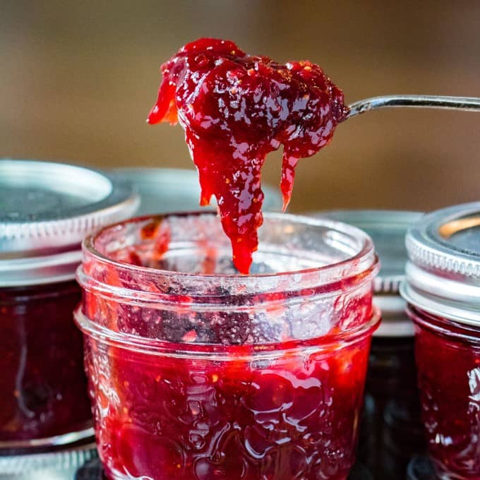 Strawberry Rhubarb Jam scooped out of a jar!