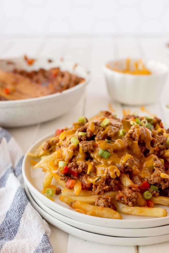 Chili Cheese Fries on white plates