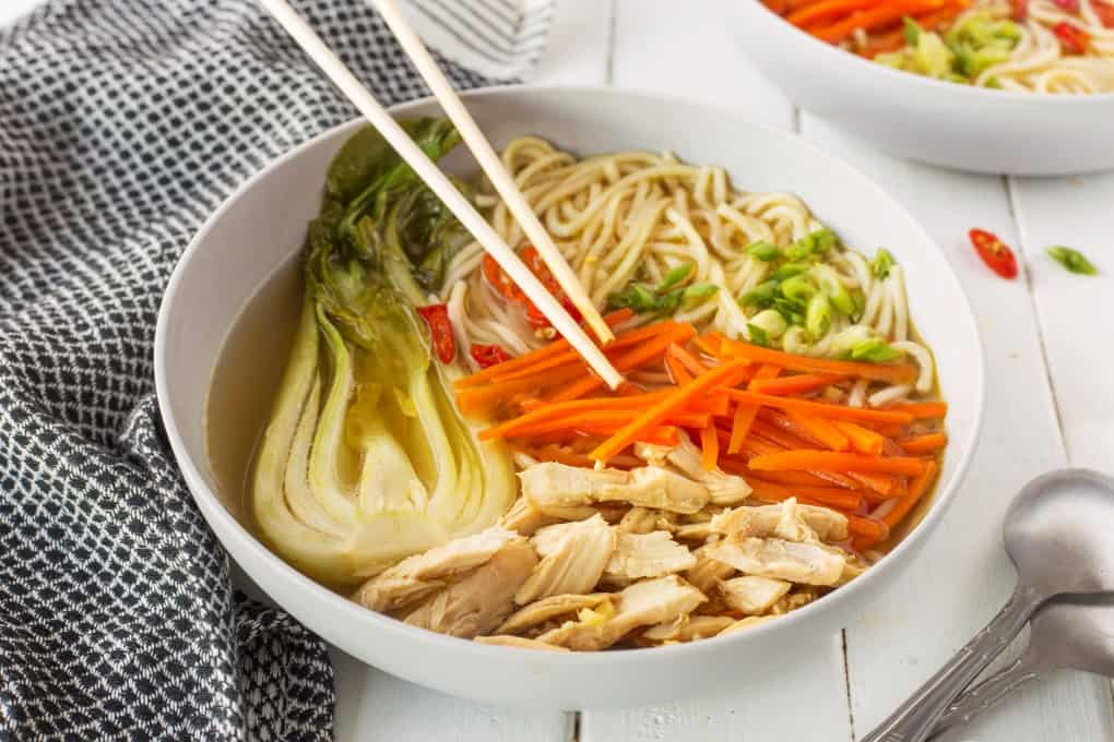 Bowl of Chinese Chicken Noodle Soup with chopsticks